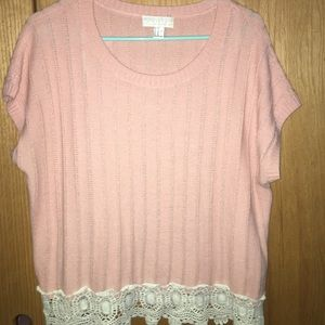 A baby pink quilted blouse.